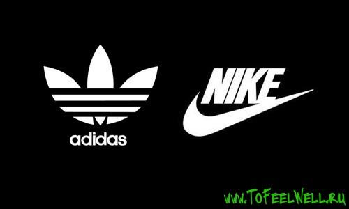 логотипы найк и адидас на черном фоне