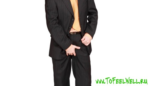 мужчина в черном костюме на белом фоне