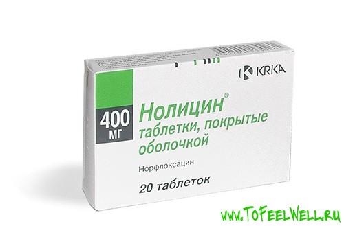 упаковка таблеток нолицин на белом фоне